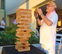 Rick Keelan, Alan Nelson and Melissa Marton competed in the Giant Jenga challenge until...