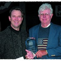 Jim Kendall presents Dave Neuharth with AFCP's Distinguished Service Award.